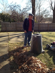 Ben helping his dad bag up the leaves in the yard.