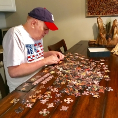 Ben working his new Birthday puzzle.